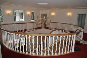Oak handrail on barley twist spindles. staircase glossary.