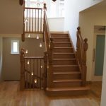 Oak stairs with newel posts.