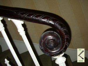A handrail carved Ram's horn or verticle scroll, side view. glossary terminology