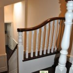 An opening cap on a short newel