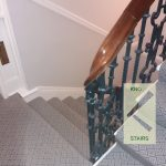 Cut string stairs with side mounted balusters.