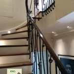 Decorative metal balusters stringer mounted on a timber staircase.