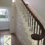 Turned spindles on cut string stairs with spandrel panel.