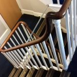 Continuous handrail over newel posts without newel caps..