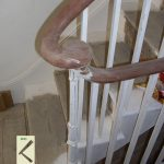 This is an example of a Monkey's tail with the landing handrail connecting in to the Newel post.