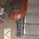 Cast newel floor mounted.