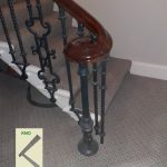 Cast newel mounted on the floor. side view.