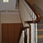 Offset cast newel post with opening cap set over.